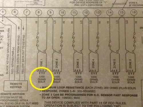 Burglar alarm wiring diagram insiide panel lid, showing EOLR values