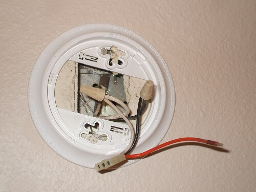 Install the new smoke detector base plate