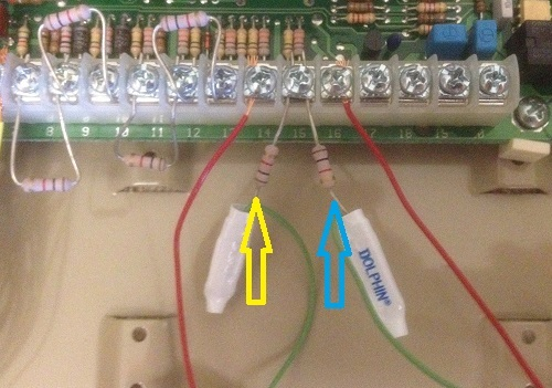 Alarm panel wiring showing Common Ground and Zone terminals. Arrows point to end-of-line resistors