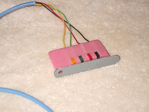 Alarm programming connector with keeper attached