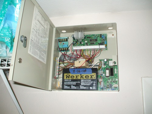 Burglar alarm battery in panel