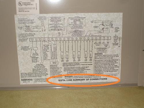 Inside of lid of Ademco Vista 10SE panel.