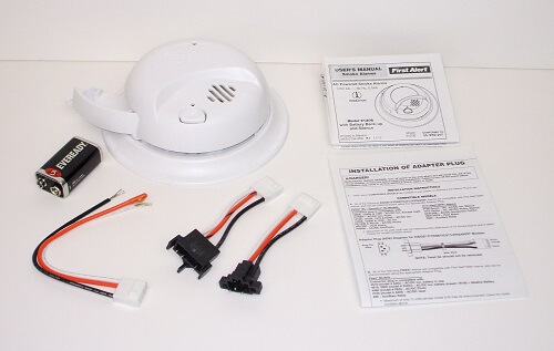 First Alert smoke alarm with pigtail harness and adapters