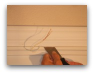 Magnetic door switch prying with putty knife