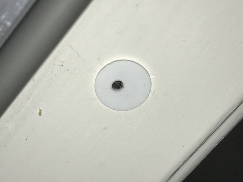 Hole drilled into magnetic reed switch body