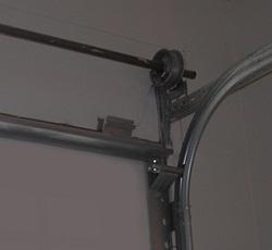 Top-mount garage door contact