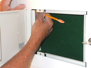 Install safe into opening and marking holes