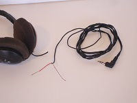 Scrap headphone cord, with one wire stripped out