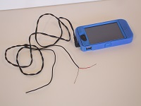 """Cord plugged into iPhone as a """"MacGyver"""" tone generator"""