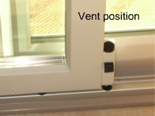 Vent door secured with foot bolt