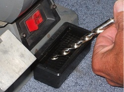 Sharpen drill bits, dipping in water