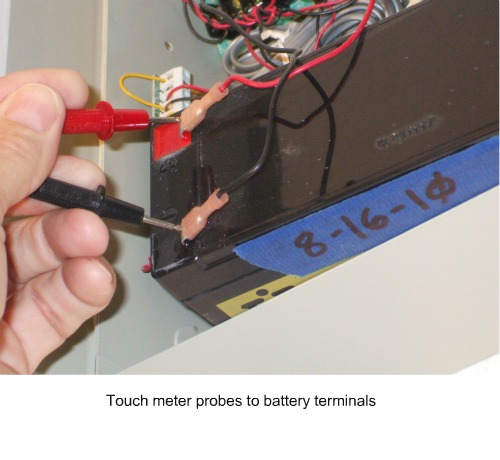 Home alarm system battery terminals