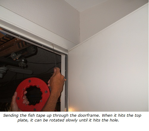 Install wiring using a fish tape, sending up into attic