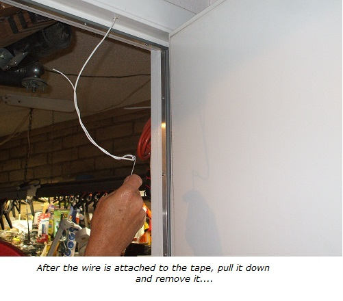 Alarm wire attached to end of fish tape