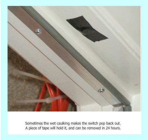 Magnetic door sensor taped in place