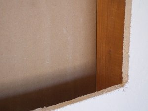 Opening cut out for wall safe, with small gap to be shimmed