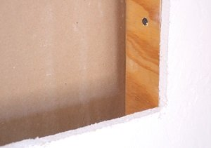 Small gap, shimmed with scrap plywood