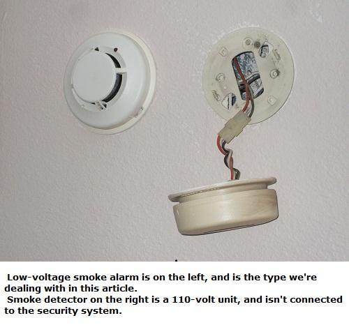 110-volt smoke detector beside low-voltage smoke alarm