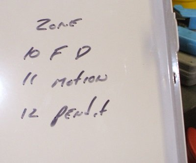 Zone list written inside lid of an Ademco Vista 10SE using 3 of its 6 available zones