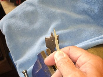 How to sharpen drill bits using a diamond file